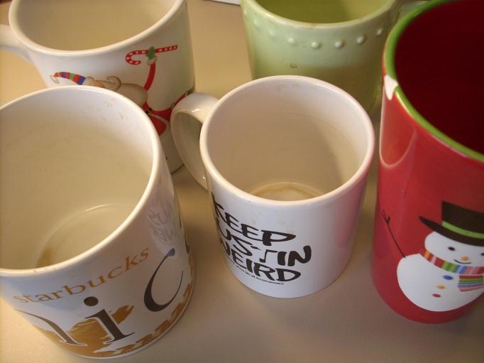 Yep - FIVE DIRTY COFFEE CUPS!