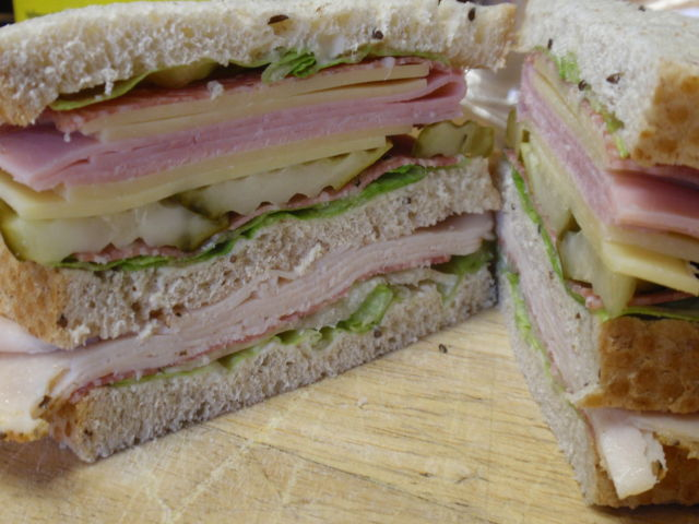 this baby has light mayo, sweet pickles, ham, volpi salami, italian roasted turkey breast and swiss cheese!