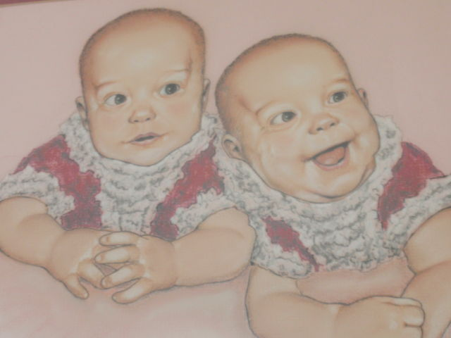 This is a painting that my Dad made of me and my twin sister when we were probably 4 or 6 months old?  Don't know which one I am though!