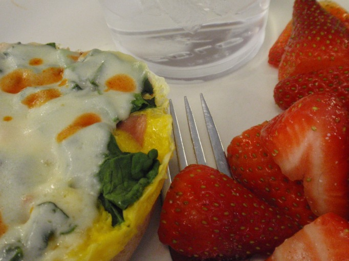 Strawberries with my usual egg sammie - and a big glass of water!
