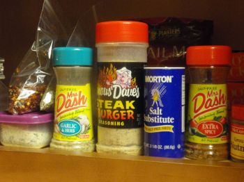 crushed red pepper, Italian seasoning, the container on the left is garlic salt - love the Mrs. Dash Extra Spicy!