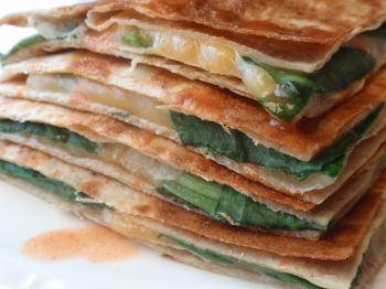2 low carb tortillas (14 grams of fiber!), 1/4 cup Mexican cheese and a cup of baby spinach - Pam fried!