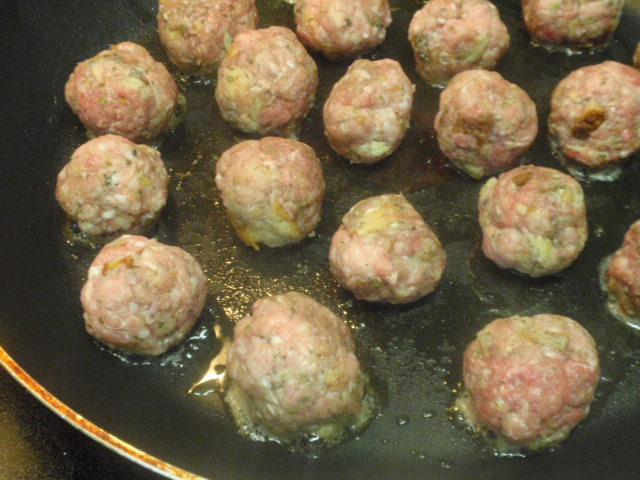 My meatballs only cooked in about 1/2 teaspoon olive oil and Pam, just so they wouldn't stick to the pan and get crispy all the way around