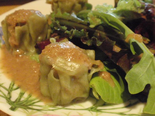 we split an appetizer of these - pork wasabi dumplings - spicy!
