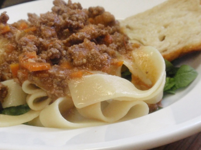 My plate - 1.5 ounce bread, 4 ounces cooked pasta, baby spinach, and meat sauce