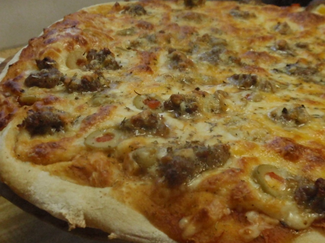 Our pizza - all sausage - Tony half green olive, my half had mixed diced peppers